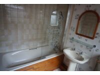 Complete bathroom suite comprising of bath with mixer taps & shower head, basin with taps & toilet
