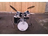 Performance Percussion black drum kit with cymbals, sticks and music stand.