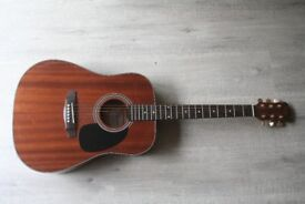 Redwood's right-handed acoustic guitar