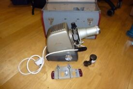 Projector for slides and film rolls