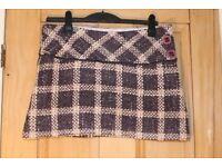 Short skirt. Never worn, tag still attached.