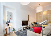 Modern studio apartment -completely renovated .
