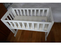 White crib can be bedside or standalone