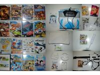 Nintendo Wii Console with giant bundle of 23 Games, Wii Fit board, Guitar and Dance Matt