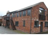 Office in converted builders yard in Rectory Road, Canton