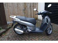 Honda sh125i, very reliable and super low milage