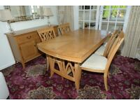 diningroom suite, extendable table 4 chairs and a sideboard.