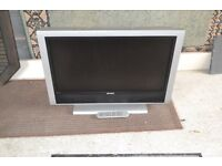 Accoustic solutions 32 inch tv with remote control.
