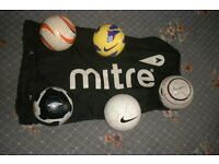 footballs plus carry bag