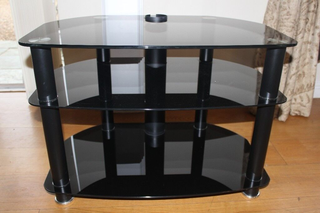 Contemporary glass and chrome TV stand with 3 shelves for Sky box etc. Hardly used, good quality.