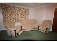 Three piece suite - sofa, armchair and electric recliner