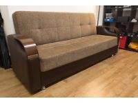3-4 SEATER COMFORTABLE SOFA BED WITH STORAGE IN EXCELLENT CONDITION.
