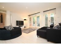 An Extremely Modern Two Bedroom Apartment With A Private South-West Facing Garden