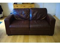 Used stylish and modern 2-seater brown leather sofa - excellent price for quick sale!