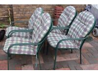 Four metal stackable chairs, with full removeable cushions, green