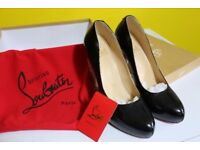 Christian Louboutin black shoes size 6 worn once for graduation heel and sole guards still attached.