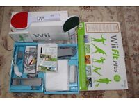 Nintendo Wii rarely used in original box including Wii Fit Plus board and games