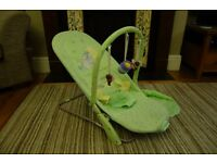 Light green, Disney's Winnie the Pooh vibrating baby chair. V good condition, smoke/pet-free home.