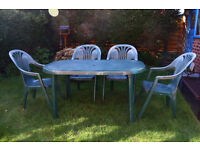 Garden table with 4 stacking chairs , green . £15