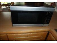 Lovely modern looking microwave in black and steel