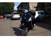 Vespa gts 300 super with Helmet. (Good condition, Low mileage)