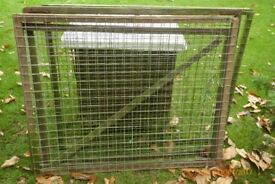 Galvanised mesh panels to contain pets