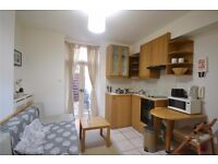 AIR CONDITIONED self contained studio flat with kitchen, en-suite shower/wc & PATIO GARDEN.