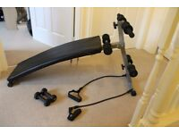 Incline workout bench with resistance bands and dumbbells plus holder