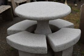 pink granite round table and stools