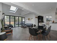 A lovely modern and spacious stunning two bedroom house arranged over three floors