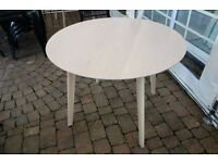 Round dining/kitchen table - limed oak finish. Only one month old - like new
