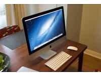 iMac 21.5-inch with keyboard and magic mouse
