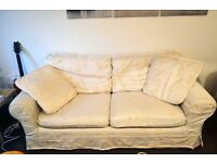 Pair of cream fabric sofa couches - 2 and 3 seaters - urgent, must collect