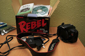 Canon 550D /Rebel T2i camera + 2 batteries + 32 GB Lexar SDHC memory card