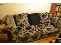 Black and grey patterned fabric three-seater sofa
