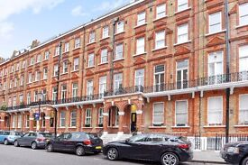 SHORT LET- Nevern Square SW5. Raised ground floor one double bedroom apartment to rent long let.