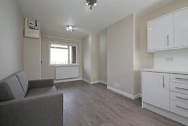 Neatly-presented ground floor studio flat, available to let in Churston Close, SW2