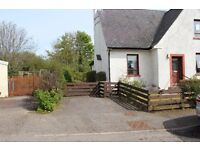 For sale 3 bedroom semi-detached house with extensive grounds and the potential for development.