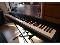 YAMAHA P85 DIGITAL PIANO. Full keyboard, 88 weighted keys. Stand and stool included.