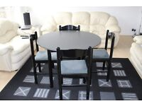 Round dining table complete with 4 matching chairs