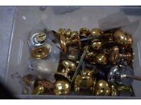 Box of brass door handles and window furniture