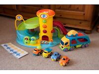 ELC Whizz Around Garage (plus car transporter and construction vehicles) - RRP £72