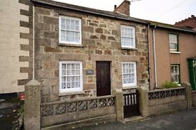 Traditional three bed cottage in center of Helston with off road parking,garage & garden.
