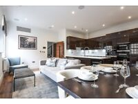 A stunning three double bedroom penthouse in an outstanding gated development, Rainville, W6