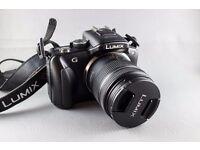 Panasonic Lumix DMC-G3 camera with G VARIO 14-42mm f/3.5-5.6 Lens