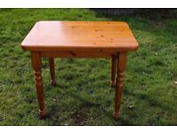 small solid well made pine table with screw legs