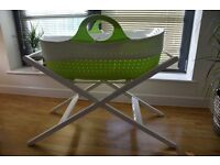 Moba Moses Basket with stand and x2 fitted sheets for £60.