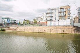 Massive 2bed 2bath flat in great development overlooking canal! Must View!