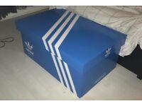 Giant wooden Adidas trainer storage