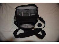 Small shoulder bag Lowepro Nova 160AW. Holds Nikon DSLR plus one lense and Flash